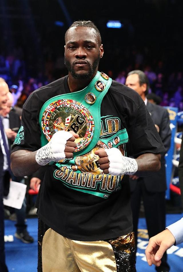 Deontay Wilder poses after knocking out Bermane Stiverne in the first round during their rematch for Wilder's WBC heavyweight title, at the Barclays Center in New York, on November 4, 2017 (AFP Photo/AL BELLO)