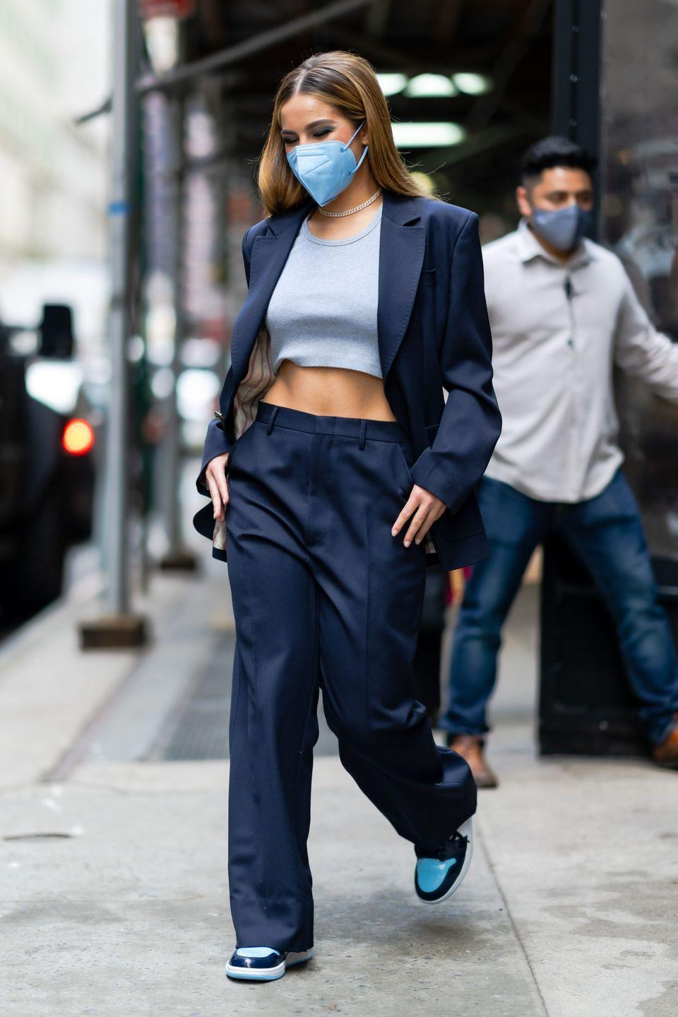 <p>No offence, but a navy blue suit really could easily look mom as hell. But with a cropped tank and sneakers it reads perfectly laid-back. </p>