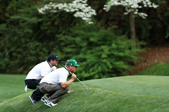 U.S. golfers Patrick Reed and Charley Hoffman (R) look at the 13th green before making their putts during second round play of the 2018 Masters golf tournament at the Augusta National Golf Club in Augusta, Georgia, U.S., April 6, 2018. REUTERS/Lucy Nicholson