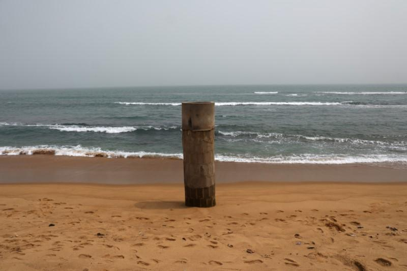 The remains of a well that was damaged by storms lashing into coast, stands in Baguida