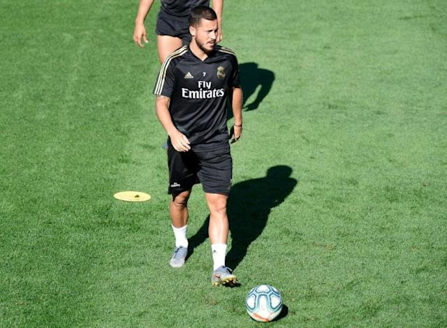 Belgian forward Eden Hazard faces a wait for his Real league debut owing to a thigh strain (AFP Photo/JAVIER SORIANO)