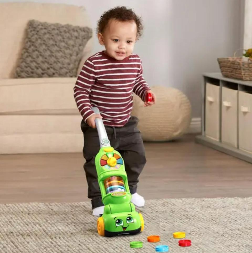 """Teach your toddler to pick up after themself while making it seem like """"fun.""""Requires 4 AA batteries.<br /><br /><strong>Promising review:</strong>""""Daughter loves Leapfrog toys and this is no exception. She's younger than the recommended age, so I'm holding on to the smaller parts (dustbin and colored disks) and she uses the vacuum to play/pretend vacuum. She loves the buttons, the lights, and sounds. I find all of it annoying haha, but it's effective and engaging, so that's what matters."""" --<a href=""""https://go.skimresources.com?id=38395X987171&xs=1&url=https%3A%2F%2Fwww.target.com%2Fp%2Fleapfrog-pick-up-38-count-vacuum%2F-%2FA-79406282&xcust=HPToddlerBirthday60919842e4b02e74d22c817c"""" target=""""_blank"""" rel=""""noopener noreferrer"""">Jillibeanrenee</a><br /><br /><strong>Get it from Target for <a href=""""https://go.skimresources.com?id=38395X987171&xs=1&url=https%3A%2F%2Fwww.target.com%2Fp%2Fleapfrog-pick-up-38-count-vacuum%2F-%2FA-79406282&xcust=HPToddlerBirthday60919842e4b02e74d22c817c"""" target=""""_blank"""" rel=""""noopener noreferrer"""">$26.99</a>.</strong>"""