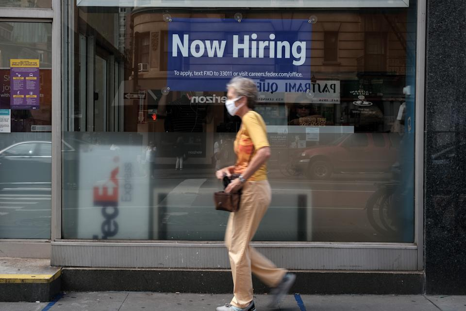 NEW YORK, NEW YORK - AUGUST 19: A hiring sign is displayed in a store window in Manhattan on August 19, 2021 in New York City. Despite continued concerns about the Delta variant of the Covid virus, the United States economy continues to grow with the  leading economic index jumping 0.9% last month. (Photo by Spencer Platt/Getty Images)