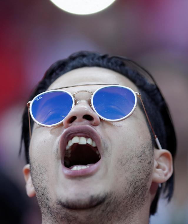 Soccer Football - World Cup - Group G - Tunisia vs England - Volgograd Arena, Volgograd, Russia - June 18, 2018 Fan wearing sunglasses inside the stadium before the match REUTERS/Ueslei Marcelino