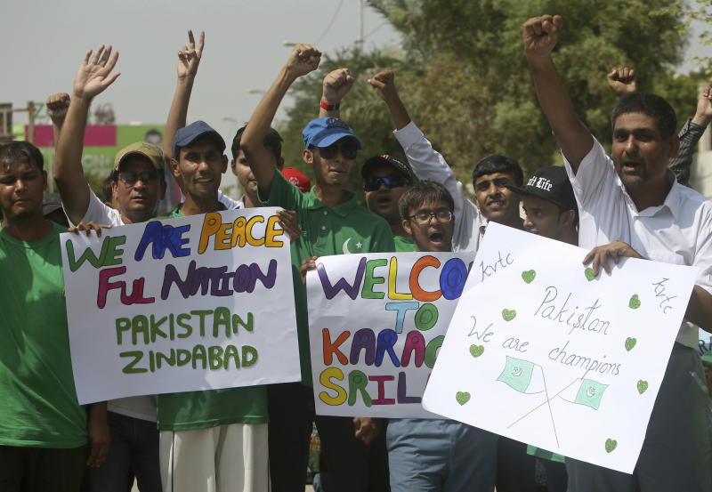 Pakistani cricket fans celebrate the Pakistan--Sri Lanka cricket series outside the National stadium in Karachi, Pakistan, Monday, Sept. 30, 2019. Karachi's 10-year long wait to host a one-day international finally ended on Monday as Pakistan won the toss and elected to bat against Sri Lanka in the second ODI. (AP Photo/Fareed Khan)