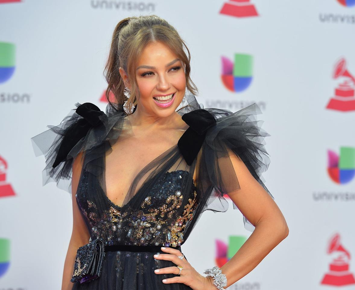 <p>At the 19th annual Latin Grammy Awards, Thalía wore her cool blond hair in a high, slicked-back ponytail with loose, face-framing curls. She complemented her updo with rosy cheeks, bright pink lipstick, and a subtle sweep of brown eye shadow. </p>