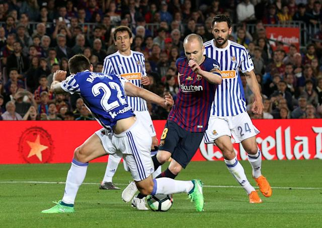 Soccer Football - La Liga Santander - FC Barcelona vs Real Sociedad - Camp Nou, Barcelona, Spain - May 20, 2018 Barcelona's Andres Iniesta in action with Real Sociedad's Raul Navas REUTERS/Albert Gea