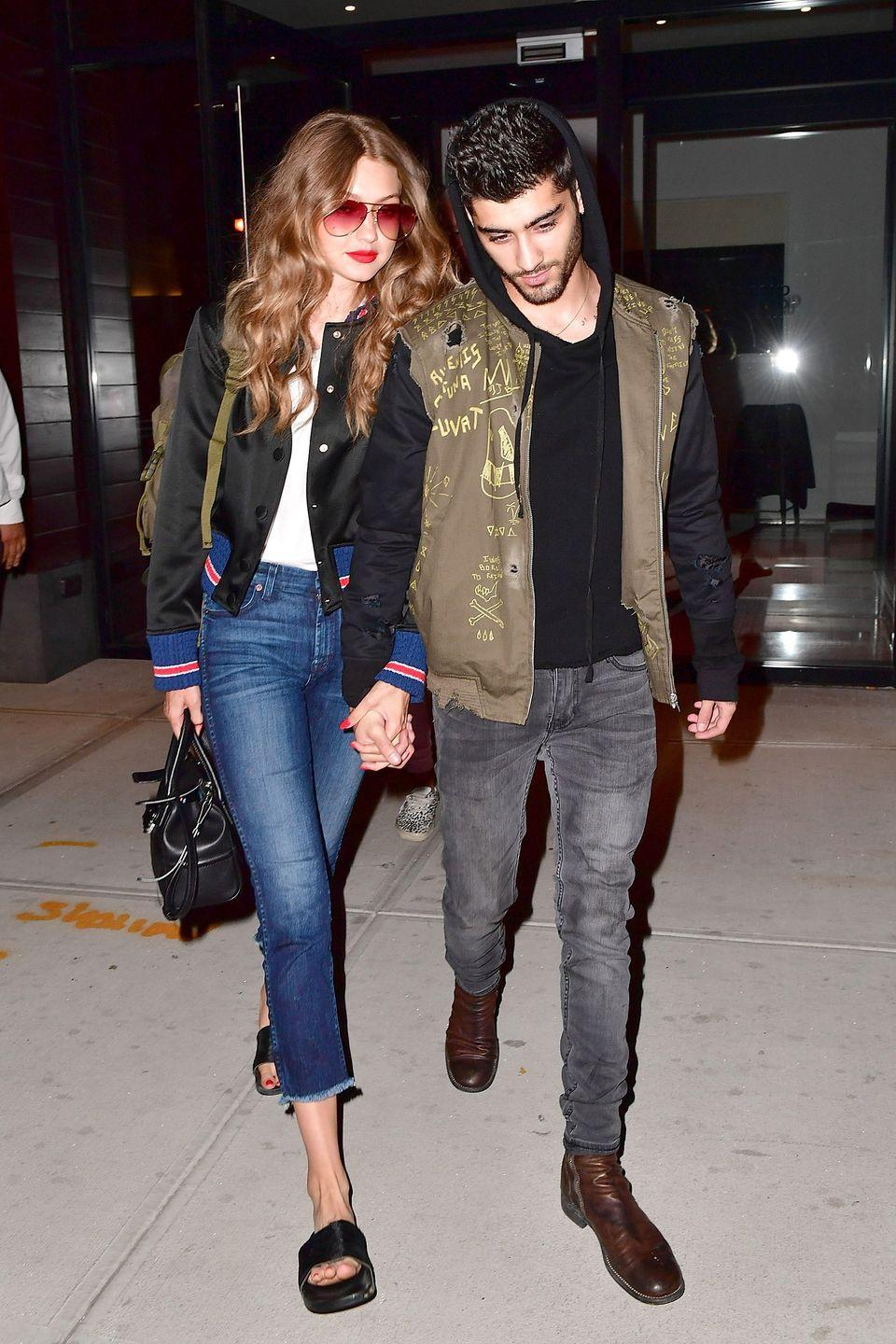 """<p>In a black bomber jacket, white tee, <a href=""""http://www.7forallmankind.com/highwaist-ankle-straight-with-raw-hem-in-acroplis-deep-sky/d/12533C19485?CategoryId=3042"""" rel=""""nofollow noopener"""" target=""""_blank"""" data-ylk=""""slk:7 for All Mankind"""" class=""""link rapid-noclick-resp"""">7 for All Mankind</a> high-waisted raw hem cropped jeans, black slides and tinted aviator sunglasses.</p>"""