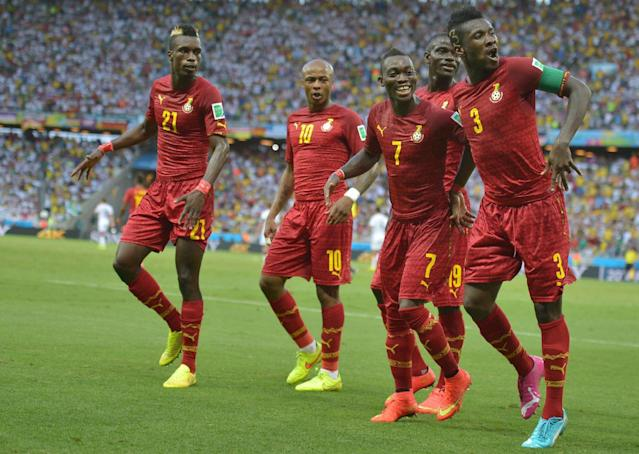 Ghana forward and captain Asamoah Gyan (R) celebrates with teammates after scoring during the World Cup Group G match against Germany at the Castelao Stadium in Fortaleza on June 21, 2014 (AFP Photo/Carl De Souza)