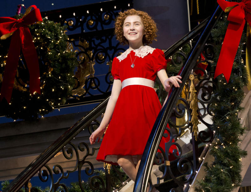 """This theater image released by Boneau/Bryan-Brown shows Lilla Crawford in the title role of the musical """"Annie,"""" in New York. Producers said Thursday, Sept. 5, that the show will have its final performance on Jan. 5 at the Palace Theater. It will have played 487 performances and 38 previews. (AP Photo/Boneau/Bryan-Brown, Joan Marcus)"""