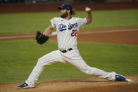 Los Angeles Dodgers starting pitcher Clayton Kershaw throws against the Tampa Bay Rays during the first inning in Game 1 of the baseball World Series Tuesday, Oct. 20, 2020, in Arlington, Texas. (AP Photo/Eric Gay)