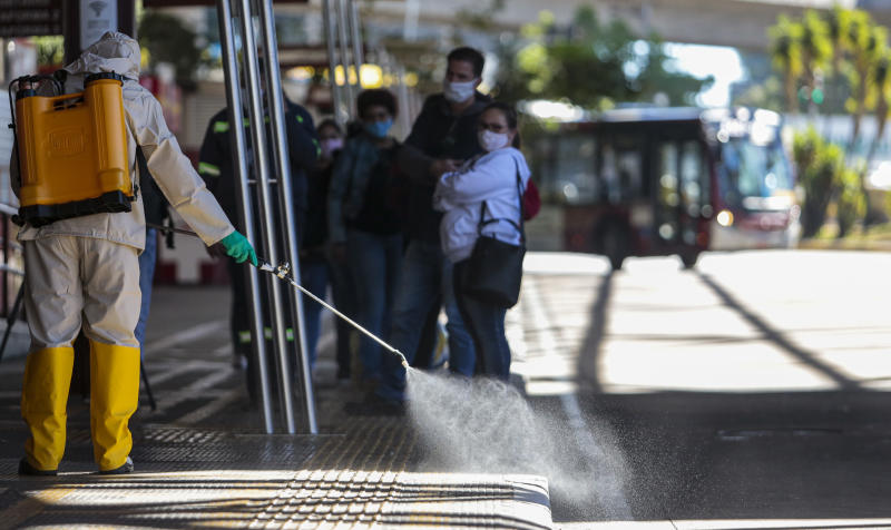 SAO PAULO, BRAZIL - MAY 25: A member of a municipal sanitization crew use mixing of sodium hypochlorite and water to disinfect and eliminate viruses and bacteria from the bus terminals on May 25, 2020 in Sao Paulo, Brazil. These measures are aimed at stopping the spreading of the coronavirus (COVID-19) pandemic. Brazil has over 367,000 positive cases of coronavirus (COVID-19) and more than 22,900 deaths. (Photo by Miguel Schincariol/Getty Images)
