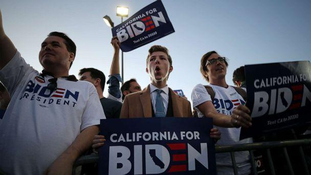 PHOTO: Joe Biden supporters hold signs ahead of Biden's Super Tuesday night event on March 03, 2020, in Los Angeles. (Mario Tama/Getty Images)