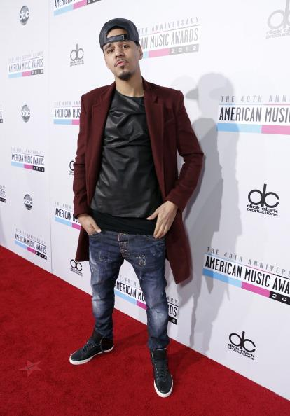 J. Cole arrives on the 2012 American Music Awards red carpet.