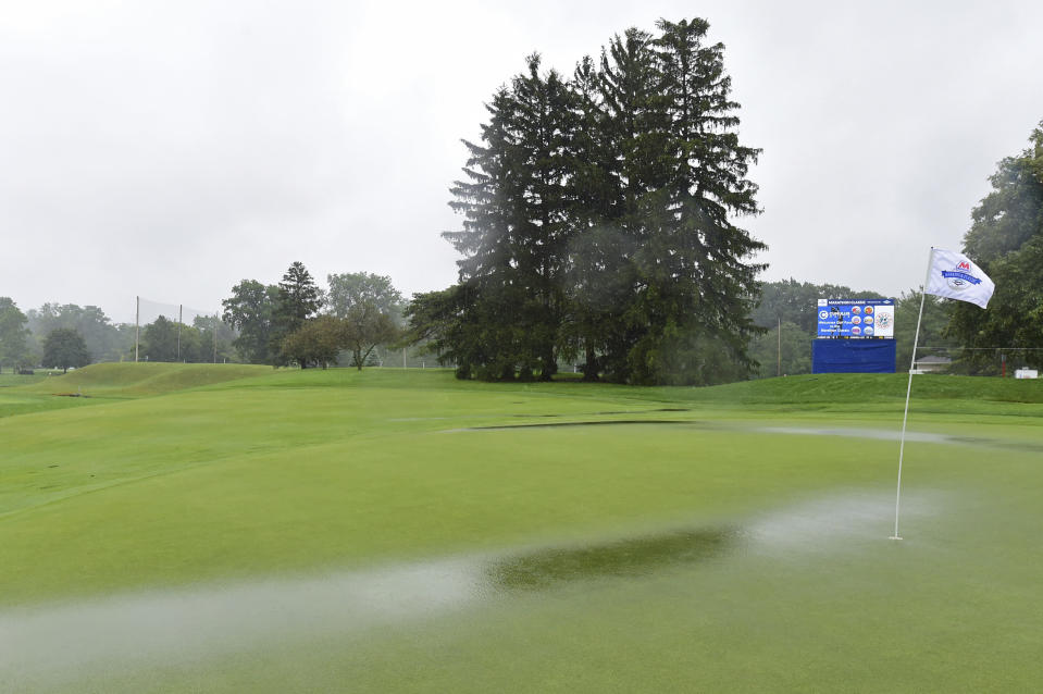 Water pools on the green of the ninth hole as play is suspended during the final round of the Marathon LPGA Classic golf tournament at Highland Meadows Golf Club in Sylvania, Ohio, Sunday, July 11, 2021, in Sylvania, Ohio. (AP Photo/David Dermer)