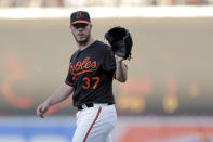 Baltimore Orioles starting pitcher Dylan Bundy waits for the ball on a throw from catcher Chance Sisco during the first inning of the team's baseball game against the Tampa Bay Rays, Friday, July 12, 2019, in Baltimore. (AP Photo/Julio Cortez)