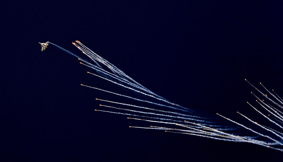 An Indian Air Force fighter aircraft Sukhoi Su-30 fires flares during Air Force Day parade at Hindon Air Force Station on the outskirts of New Delhi, India, Thursday, Oct. 8, 2020. (AP Photo/Manish Swarup)