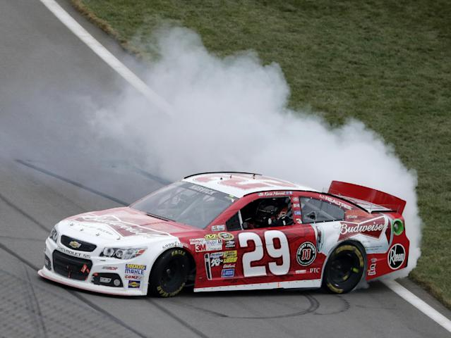 Driver Kevin Harvick does a burnout as he celebrates after winning a NASCAR Sprint Cup series auto race at Kansas Speedway in Kansas City, Kan., Sunday, Oct. 6, 2013. (AP Photo/Charlie Riedel)