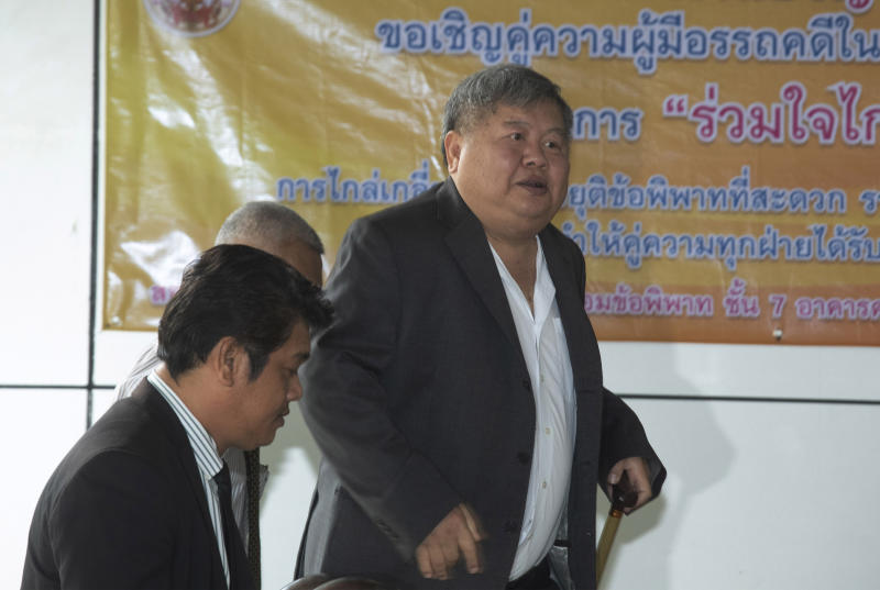 In this Wednesday, Aug. 14, 2019, photo, Thai business tycoon president of Italian-Thai Development Premchai Karnasuta arrives at the Bangkok Criminal Court in Bangkok, Thailand. Premchai was sentenced by the court to six months in prison for illegal possession for illegal possession of a firearm, which follows convictions on other charges related to his arrest last year when he and several of his employees were found in a state wildlife sanctuary with guns and the carcasses of a black panther and other animals in an alleged case of poaching. (AP Photo/Sakchai Lalit)