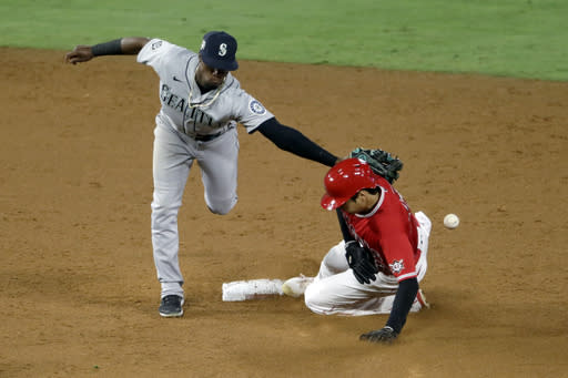 Seattle Mariners second baseman Shed Long Jr., left, misses the ball as Los Angeles Angels' Shohei Ohtani steals second base during the sixth inning of a baseball game in Anaheim, Calif., Friday, Aug. 28, 2020. (AP Photo/Alex Gallardo)