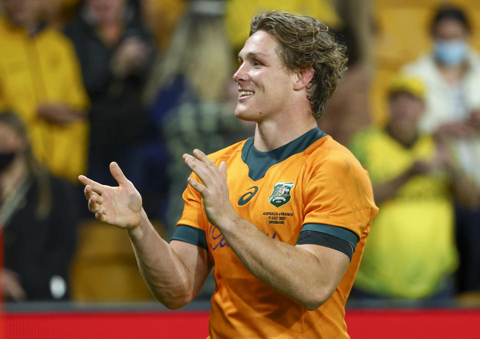 Australia's Michael Hooper celebrates after defeating France in the third rugby international at Suncorp Stadium in Brisbane, Australia, Saturday, July 17, 2021. (AP Photo/Tertius Pickard)