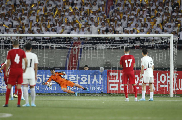 North Korea's goalkeeper An Tae Song saves a penalty during the World Cup Group H qualifying soccer match between North Korea and Lebanon at the Kim Il Sung Stadium in Pyongyang, Thursday, Sept. 5, 2019. North Korea won the game 2-0. (AP Photo/Jon Chol Jin)