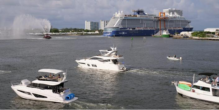 the Celebrity Edge sailing away from Port Everglades in Florida with other boats nearby.