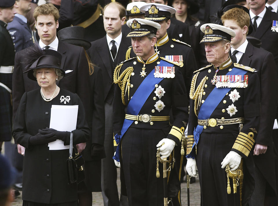 LONDON - APRIL 10:  Queen Elizabeth II; Prince Charles, the Prince of Wales and Prince Philip, the Duke of Edinburgh stand in front of Prince William and Prince Harry at the Queen Mother's funeral at Westminster Abbey in London. (Photo by Anwar Hussein/Getty Images)