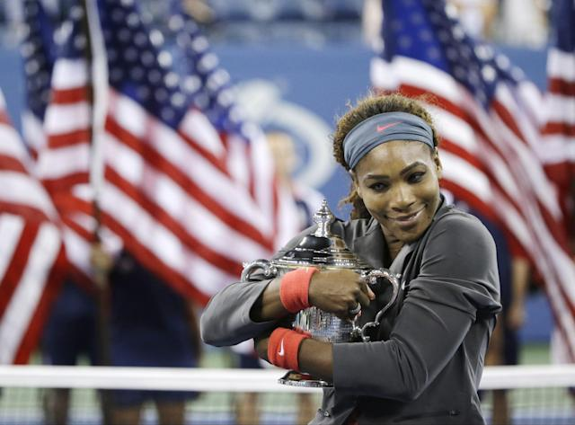 Serena Williams hugs the championship trophy after defeating Victoria Azarenka, of Belarus, during the women's singles final of the 2013 U.S. Open tennis tournament, Sunday, Sept. 8, 2013, in New York. (AP Photo/David Goldman)