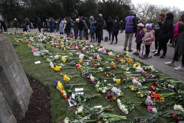 Some flowers have been left outside Windsor Castle following Philip's death (Steve Parsons/PA)