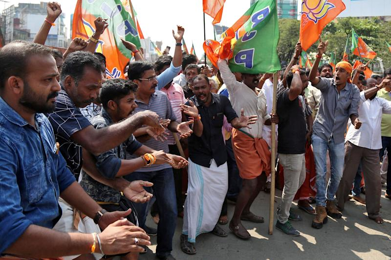 Supporters of BJP shout slogans as they block a highway during a protest against the arrest of their leader K Surendran, who police said was taken into preventive custody on Saturday night at Nilakkal base camp near the Sabarimala temple, on November 18, 2018. (Photo: Sivaram V / Reuters)