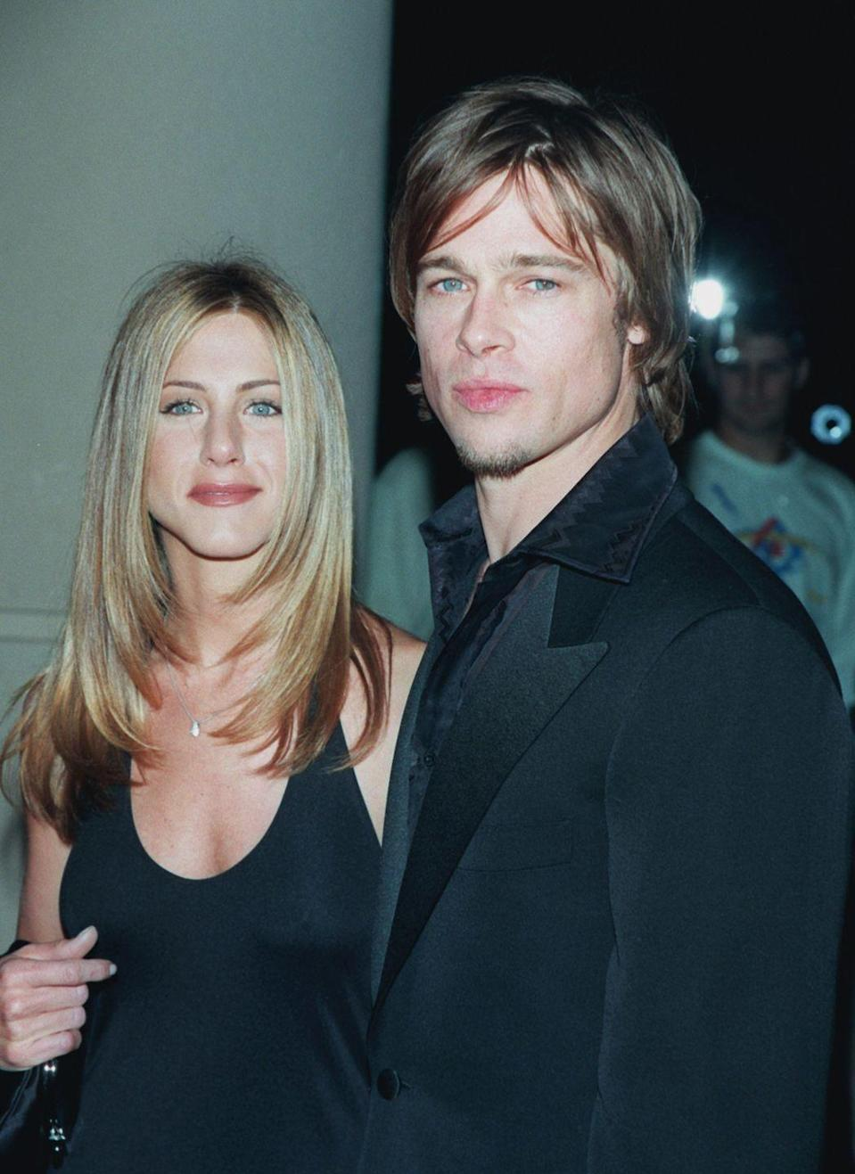 """<p>Hollywood's one-time golden couple, Jennifer Aniston and Brad Pitt, <a href=""""http://people.com/archive/cover-story-isnt-it-romantic-vol-54-no-7/"""" rel=""""nofollow noopener"""" target=""""_blank"""" data-ylk=""""slk:married"""" class=""""link rapid-noclick-resp"""">married</a> on July 29, 2000 in Malibu. The wedding reportedly cost $1 million, and Aniston's <em>Friends </em>co-stars were all in attendance. The bride wore a custom gown by Prada. The couple split in 2005. </p>"""