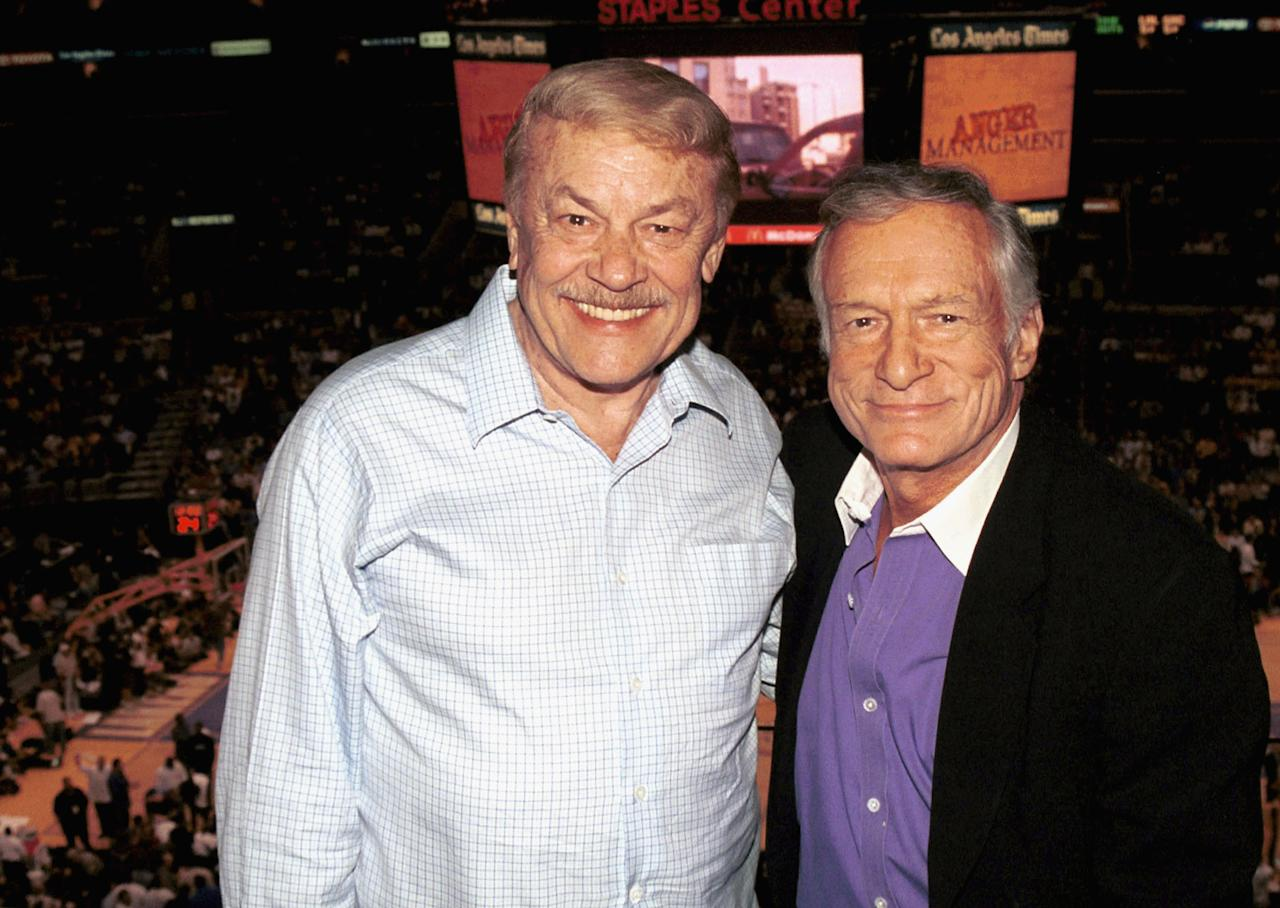 <p>HOLLYWOOD - APRIL 10: Publisher Hugh Hefner and Lakers owner Jerry Buss pose above the crowd at the Lakers v Nuggets NBA game to celebrate Hefner's 77th birthday April 10, 2003 at the Staples Center, Los Angeles, California. (Photo by David Klein/Getty Images)</p>