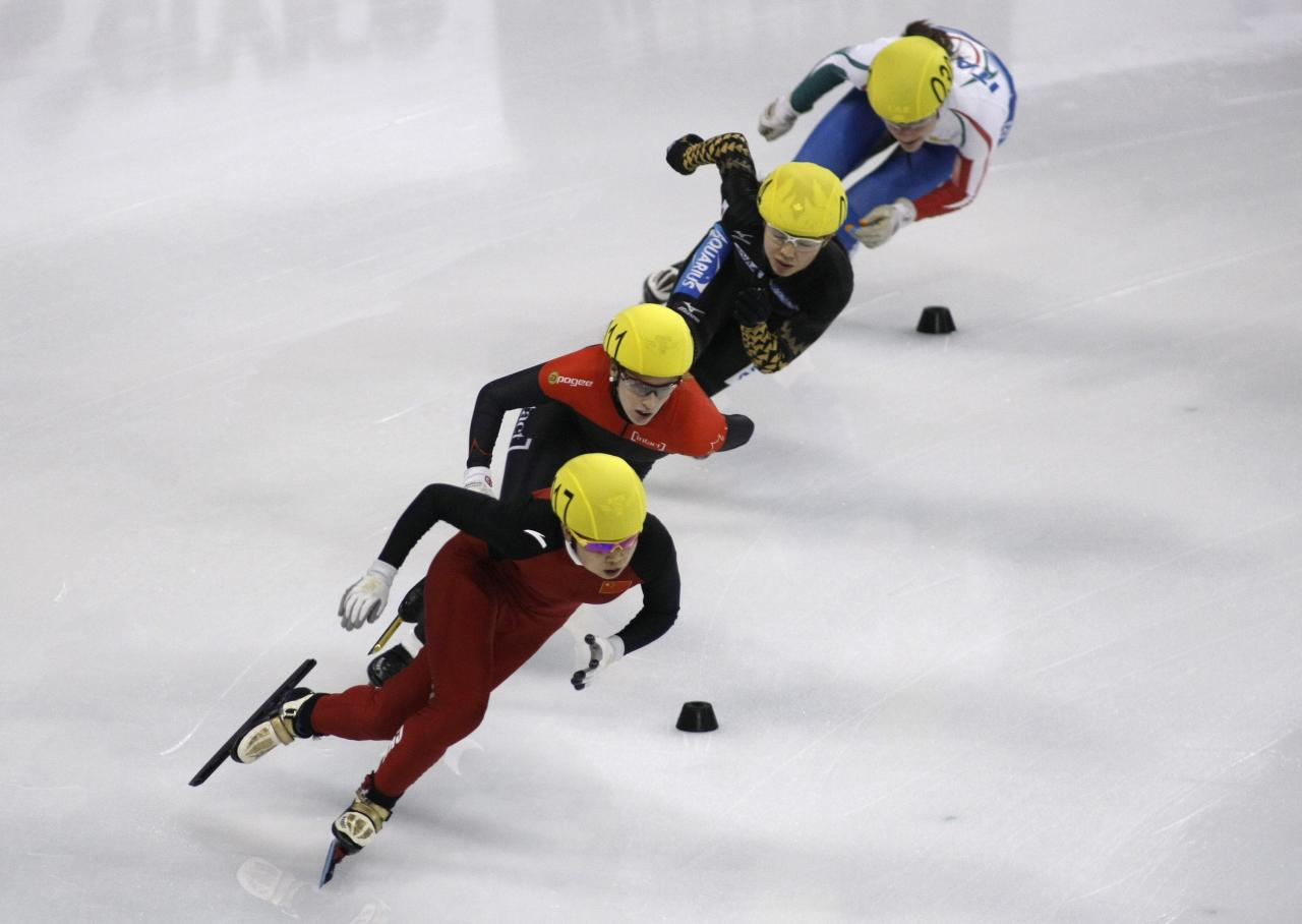 SHANGHAI, CHINA - DECEMBER 09: (L-R) Meng Wang of China, Marianne St-gelais of Canada, Ayuko Ito of Japan, Martina Valcepina of Italy compete in the Women's 3000m Relay Final during the day two of the ISU World Cup Short Track at the Oriental Sports Center on December 9, 2012 in Shanghai, China. (Photo by Hong Wu/Getty Images)
