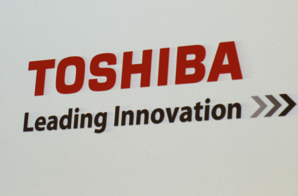 """FILE - In this June 15, 2017, file photo, the logo of Toshiba Corp., Japan's electronics and energy company, is seen on a screen during a press conference in Yokosuka, near Tokyo. Trading in Toshiba stock was halted Wednesday, April 7, 2021 after the Tokyo-based technology conglomerate confirmed it had received a preliminary acquisition proposal. Toshiba Corp. said Tuesday, April 6 it had asked for more details on the proposal, was giving it """"careful consideration"""" and would make an announcement """"in due course."""" (AP Photo/Shuji Kajiyama)"""
