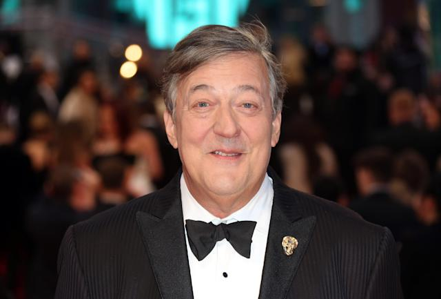 Stephen Fry poses for photographers upon arrival at the British Academy Film Awards in 2017. (Joel Ryan/Invision/AP)