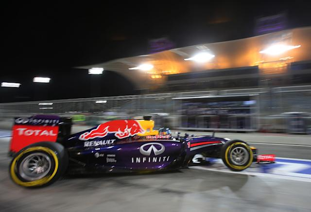 Red Bull driver Sebastian Vettel of Germany leaves the garage during the second practice session of the Bahrain Formula One Grand Prix at the Formula One Bahrain International Circuit in Sakhir, Bahrain, Friday, April 4, 2014. The Bahrain Formula One Grand Prix will take place here on Sunday. (AP Photo/Kamran Jebreili)