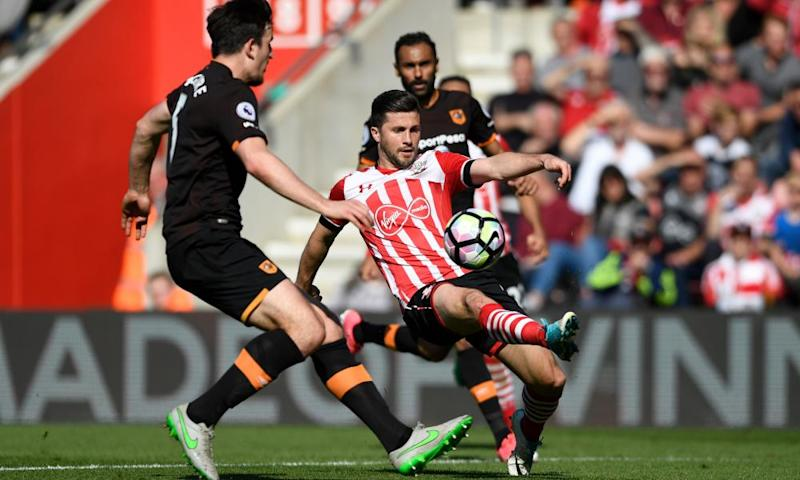 Harry Maguire, left, marshals the Southampton striker Shane Long.