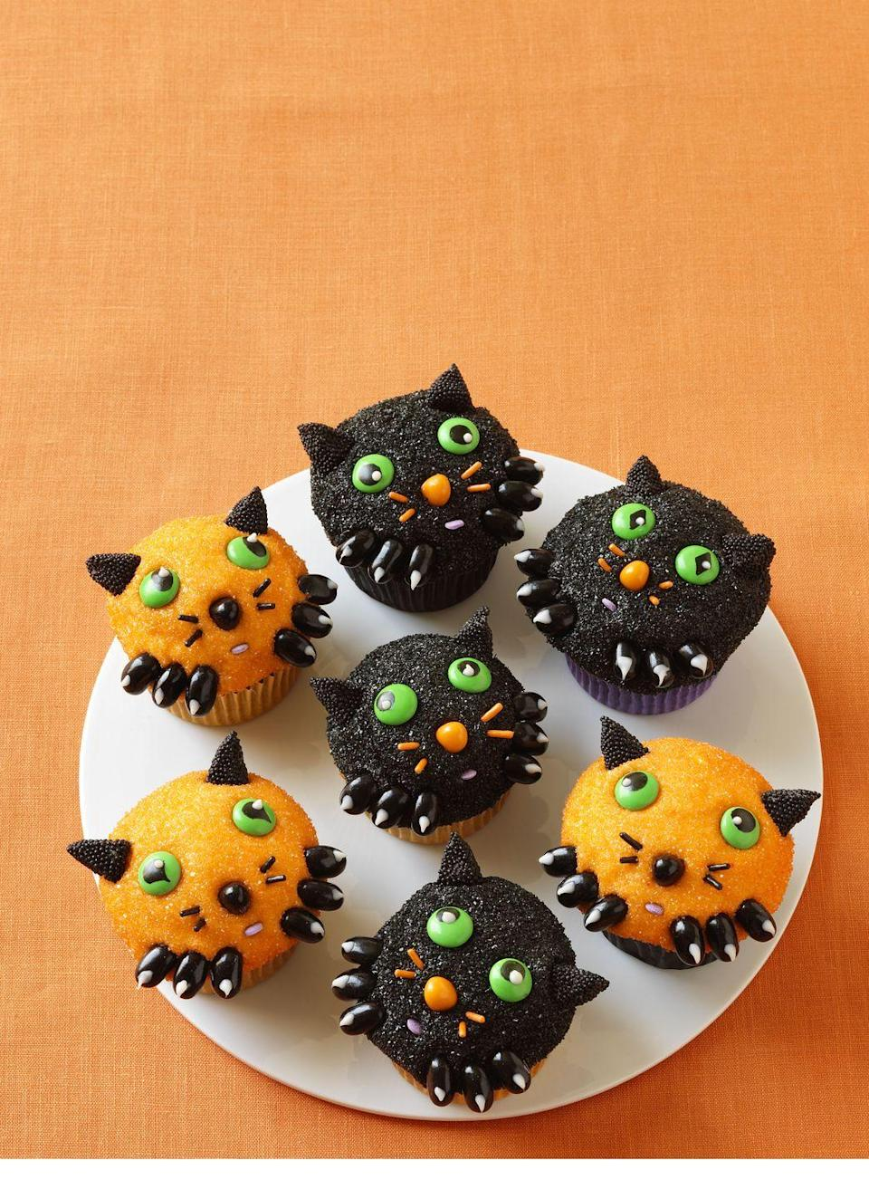 """<p>These cute chocolate cupcakes are perfect for a festive Halloween bash! Just watch out for anyone dressed as a dog ...</p><p><em><a href=""""https://www.womansday.com/food-recipes/food-drinks/recipes/a11375/kitten-cupcakes-recipe-wdy1012/"""" rel=""""nofollow noopener"""" target=""""_blank"""" data-ylk=""""slk:Get the recipe from Woman's Day »"""" class=""""link rapid-noclick-resp"""">Get the recipe from Woman's Day »</a></em></p>"""
