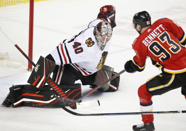 Chicago Blackhawks goalie Robin Lehner (40), from Sweden, is scored against by Calgary Flames center Sam Bennett (93) during first-period NHL hockey game action in Calgary, Alberta, Saturday, Feb. 15, 2020. (Larry MacDougal/The Canadian Press via AP)