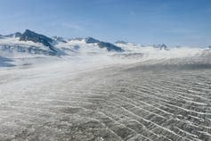 head of Shamrock glacier, with bare mountain peaks behind it