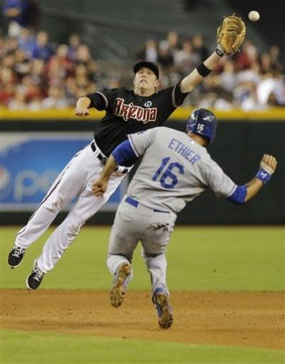 Arizona Diamondbacks' Aaron Hill can't make the catch as Los Angeles Dodgers' Andre Either steals second base during the fourth inning of a baseball game, Tuesday, July 9, 2013, in Phoenix. (AP Photo/Matt York)