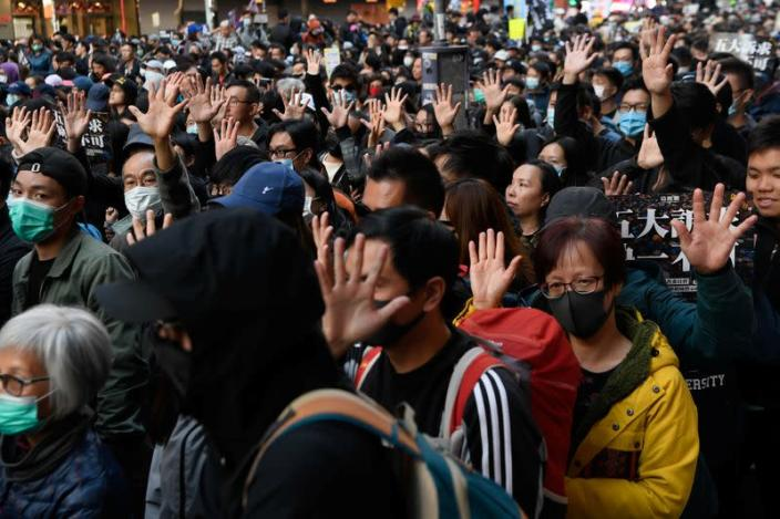 People attend a Human Rights Day march