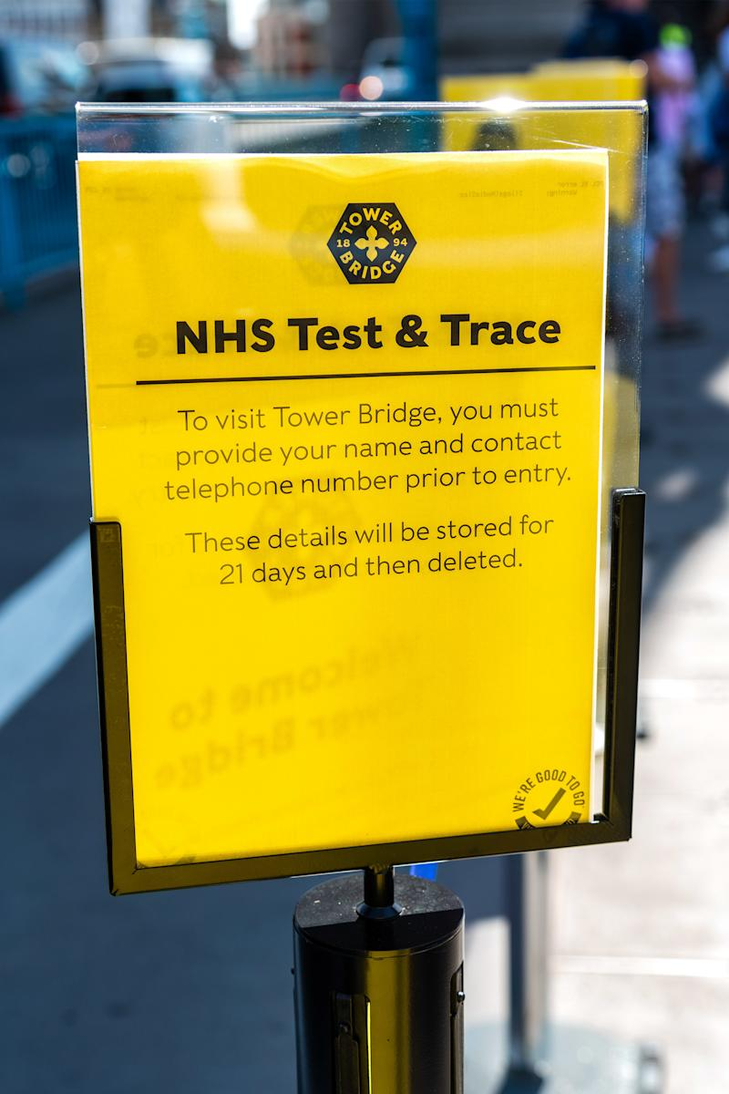 A view of a sign informing visitors that they must provide a name and contacts for the NHS Test and Trace established to track and help prevent the spread of COVID-19. (Photo by Dave Rushen / SOPA Images/Sipa USA)