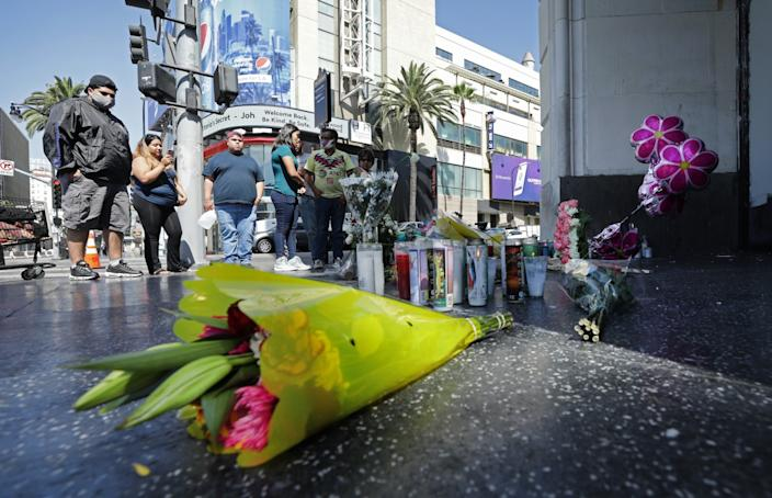 """A sidewalk memorial was set up at the corner of Hollywood Boulevard and Highland Avenue in Hollywood for Alejandra Estrada, 17. <span class=""""copyright"""">(Myung J. Chun/Los Angeles Times)</span>"""