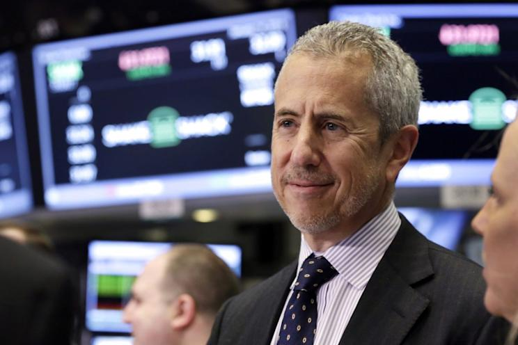 Shake Shack founder Danny Meyer visits the trading floor after opening bell ceremonies at the New York Stock Exchange, Thursday, Jan. 14, 2016. (AP Photo/Richard Drew)