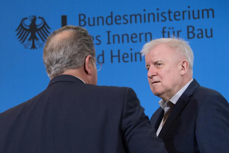15 March 2020, Berlin: Hans-Georg Engelke (l), State Secretary in the Federal Ministry of the Interior, for Building and Homeland Affairs, and Horst Seehofer (CSU), Federal Minister of the Interior, speak at a press conference in the Federal Ministry of the Interior about the borders that will be closed from tomorrow. From Monday morning, Germany will close its borders with France, Austria and Switzerland. Photo: Jörg Carstensen/dpa (Photo by Jörg Carstensen/picture alliance via Getty Images)