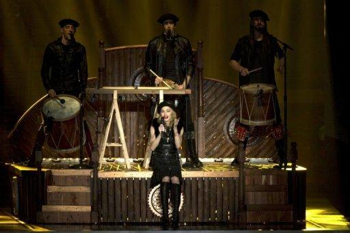 US pop icon Madonna performs on stage during her first MDNA world tour concert in the Ramat Gan Stadium, near Tel Aviv in May 2012. Madonna hit the stage running at Abu Dhabi's Yas Island stadium on Sunday in her first ever concert in the Gulf, days after launching the world tour in Israel