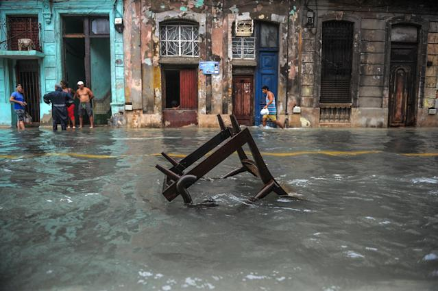 <p>A Cuban wades through a flooded street in Havana, on Sept. 10, 2017. (Photo: Yamil Lage/AFP/Getty Images) </p>