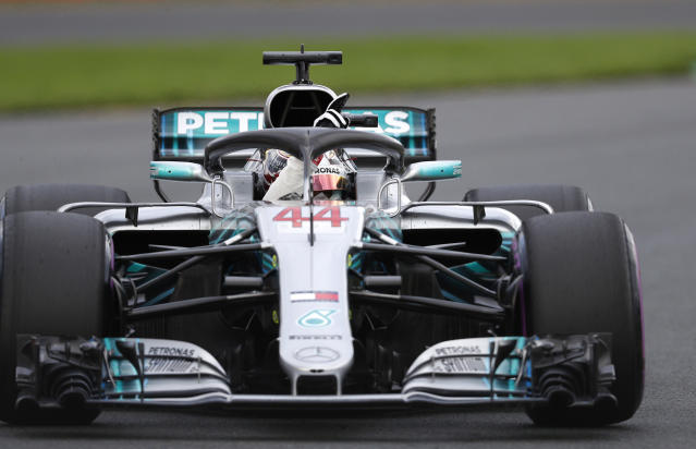 Mercedes driver Lewis Hamilton of Britain waves after qualifying at the Australian Formula One Grand Prix in Melbourne, Saturday, March 24, 2018. Hamilton has poll for Sunday's race. (AP Photo/Asanka Brendon Ratnayake)